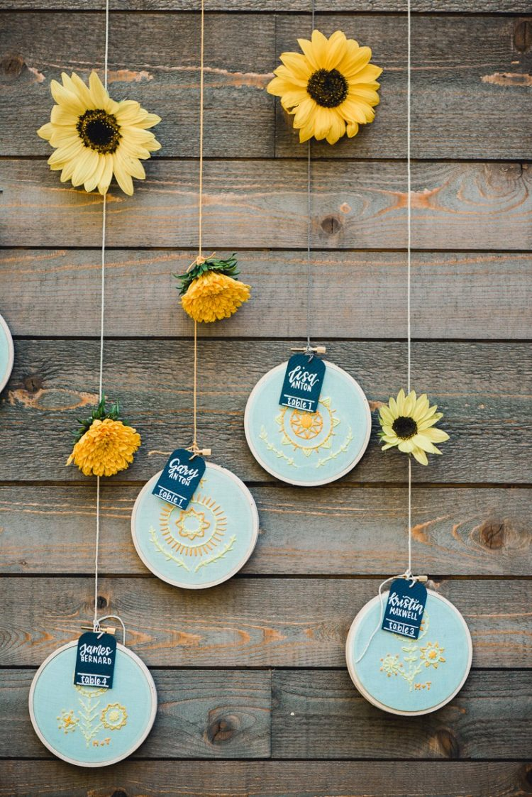 The wedding seating chart was done with sunflowers embroidered on hoops