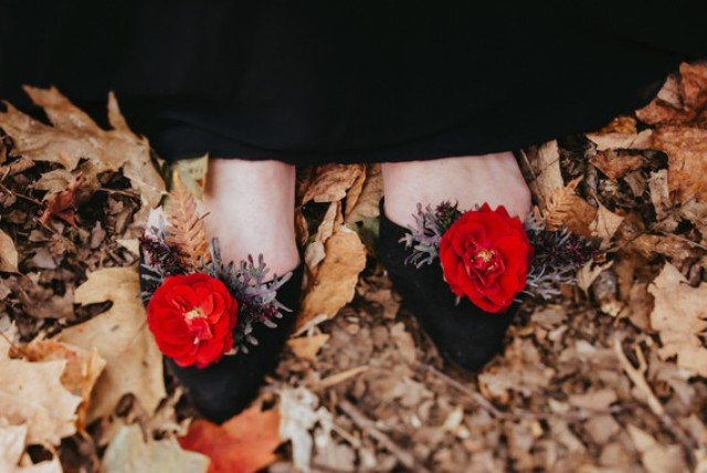 The wedding shoes were adorned with matching red blooms