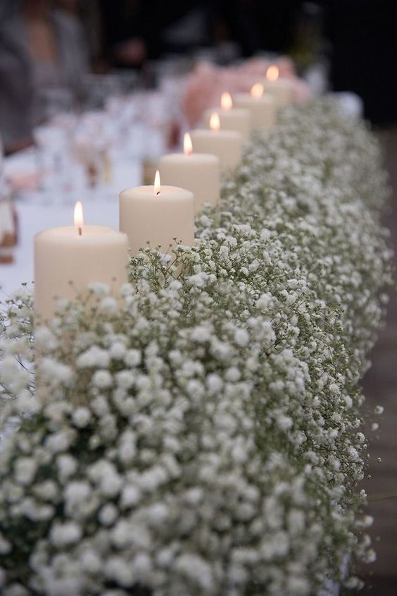 lush baby's breath table runner with candles is a chic idea for winter and other weddings