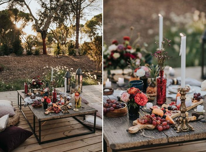 Colorful glasses, vases, gilded candle holders, wildflowers and cheese and fruit boards made it boho and decadent