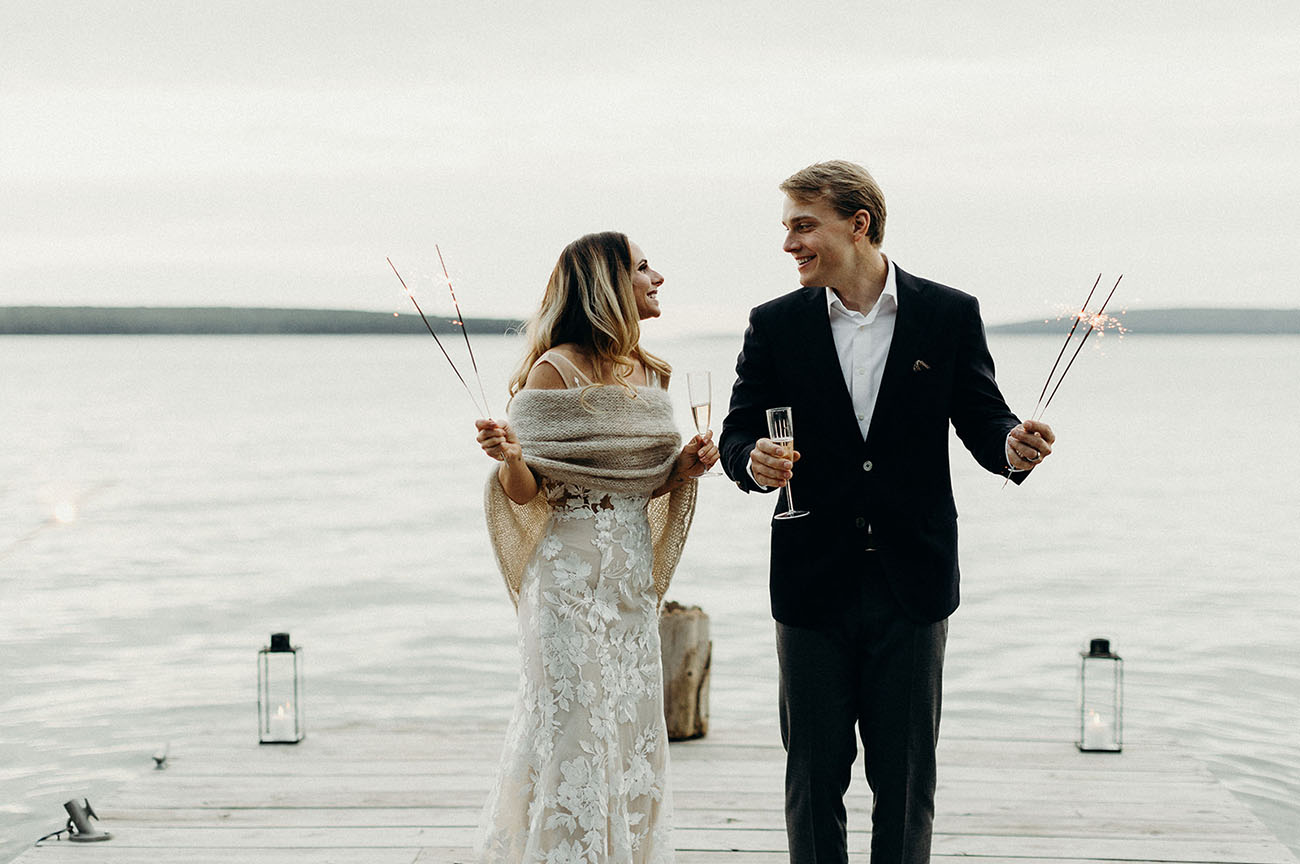 The bride covered up with a knit shawl and they went to the lake to enjoy the views and have some champagne