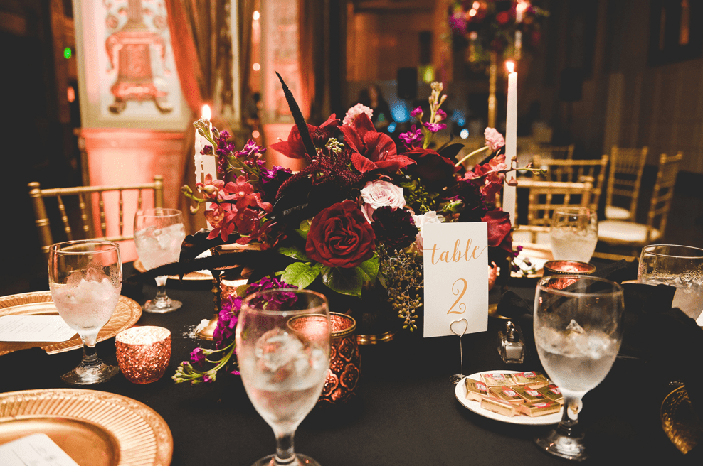 The table settings were formal and elegant, with lace inspired candle holders and black tablecloths