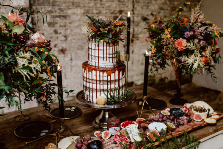 The wedding cake was a semi naked one with pomegranate dripping and lush textural herbs on top