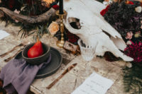 09 The wedding centerpiece was done with a large animal skull and luxurious boho blooms