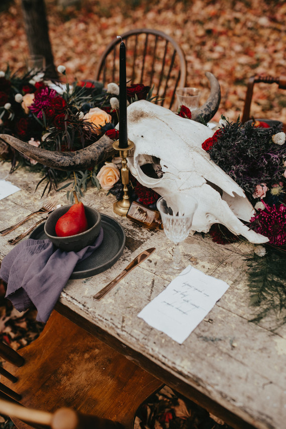 The wedding centerpiece was done with a large animal skull and luxurious boho blooms