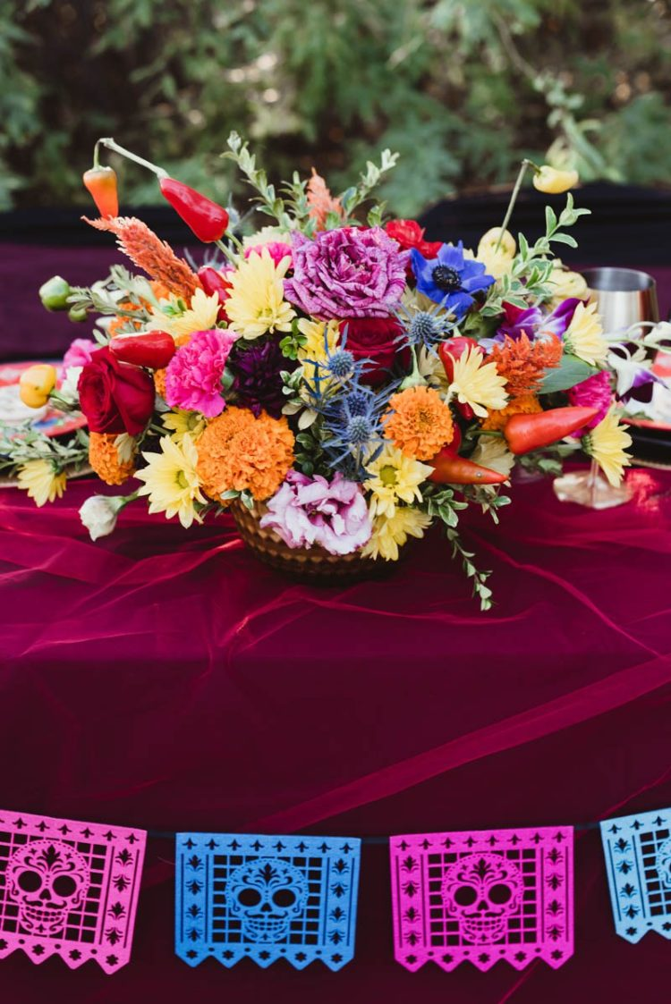 The wedding centerpiece was done with colorful blooms and hot peppers