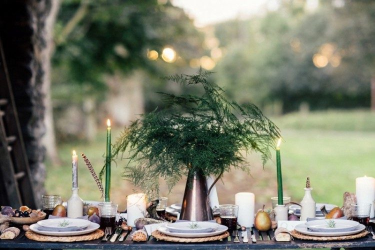 a simple Nordic wedding centerpiece of a vintage jug and ferns is great for a fall woodland-inspired fete