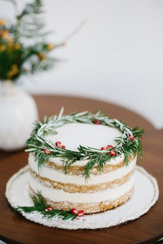 rosemary and pomegranate seeds on this gorgeous cake are a chic way to incorporate traditional holiday colors