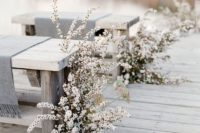 09 white blooms, whitewashed benches and grey covers create a real frozen look, which is very romantic for a winter wedding