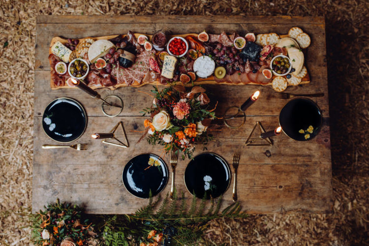 Black plates and candles added a stylish moody touch to the decor