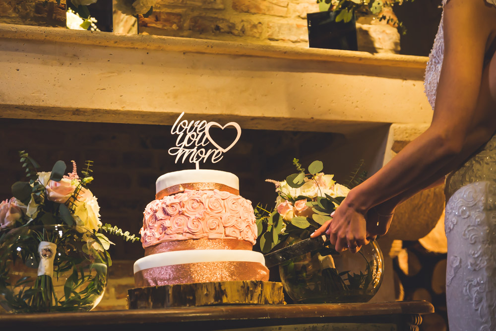 The wedding cake was a glam one, with glitter and sugar roses plus a glam and emotional topper