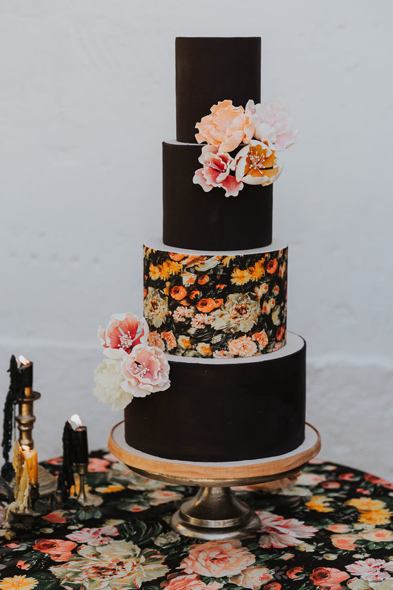 The wedding cake was done in black and with a moody floral tier, decorated with sugar blooms