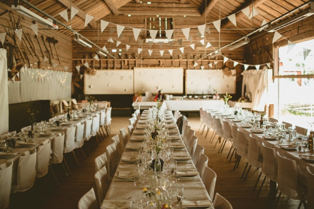 The wedding reception was done with buntings, neutral linens and florals, everything was DIY