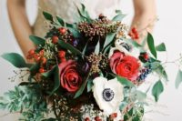 10 a bright wedding bouquet with touches of red, burgundy, with berries and foliage