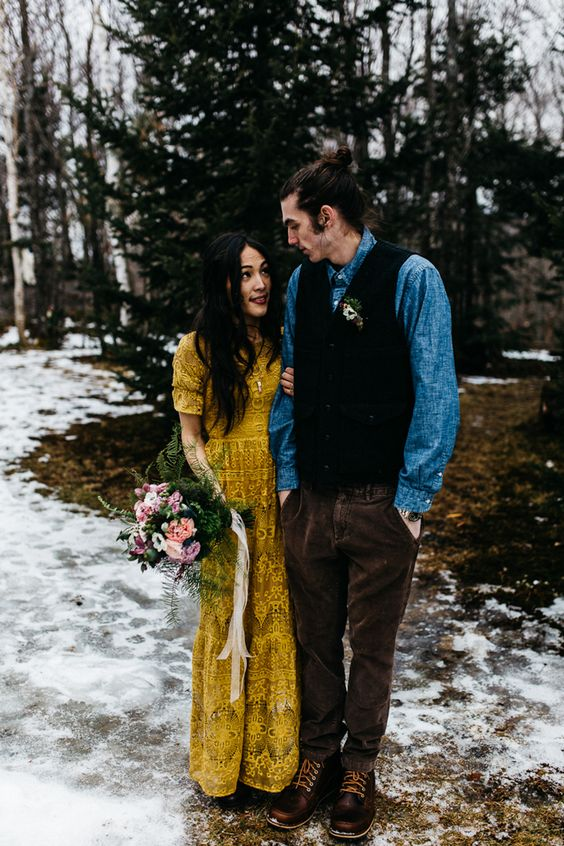 a mustard boho lace wedding dress with short sleeves and a high neckline for a woodland or mountain bride