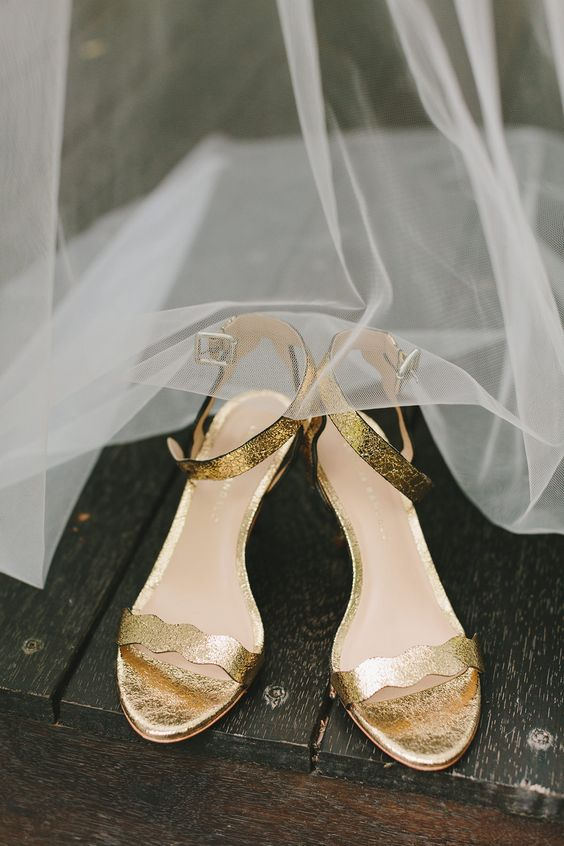gold wedding shoes with ankle straps and cutout straps for a glam and a bit retro bridal look