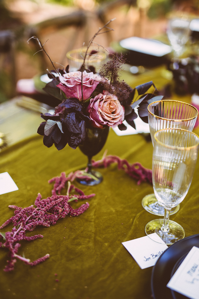The wedding centerpieces were dark and pink ones, with herbs and foliage