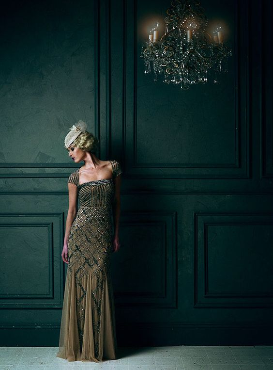 a brown and gold beaded geometric wedding dress with cap sleeves is ideal for an art deco bride