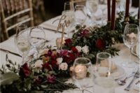 11 a chic floral table runner with lush greenery, blush and burgundy blooms plus matching candles