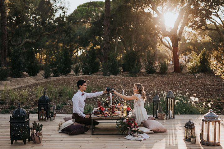 The couple enjoyed a sunlit picnic together surrounded with lanterns and cacti