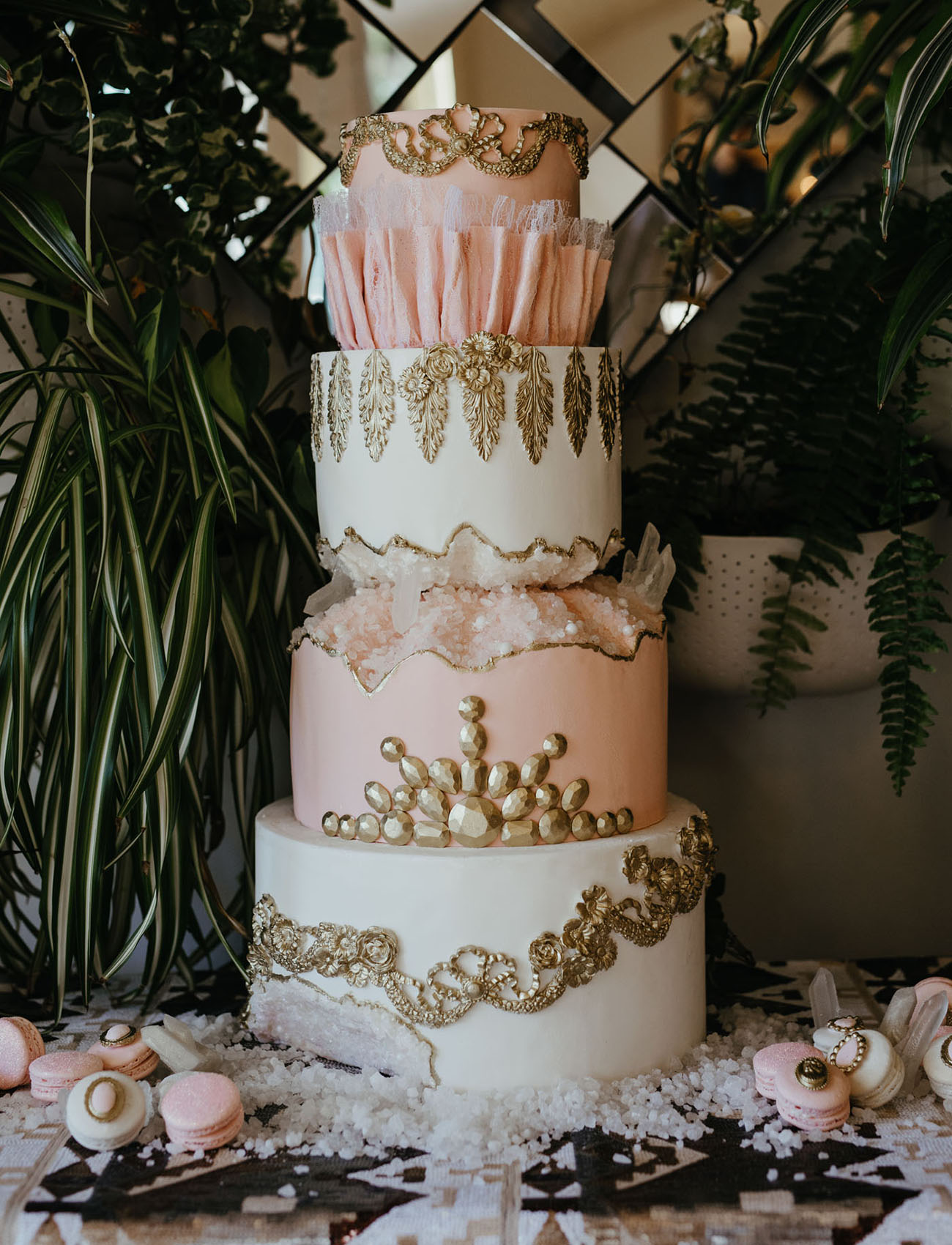 The wedding cake wa s aregal one with edible gold patterns, geodes and rhinestones for a Victorian touch