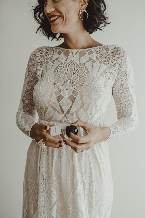 a chic boho-inspired geometric wedding gown with a fitting silhouette, long sleeves and a high neckline
