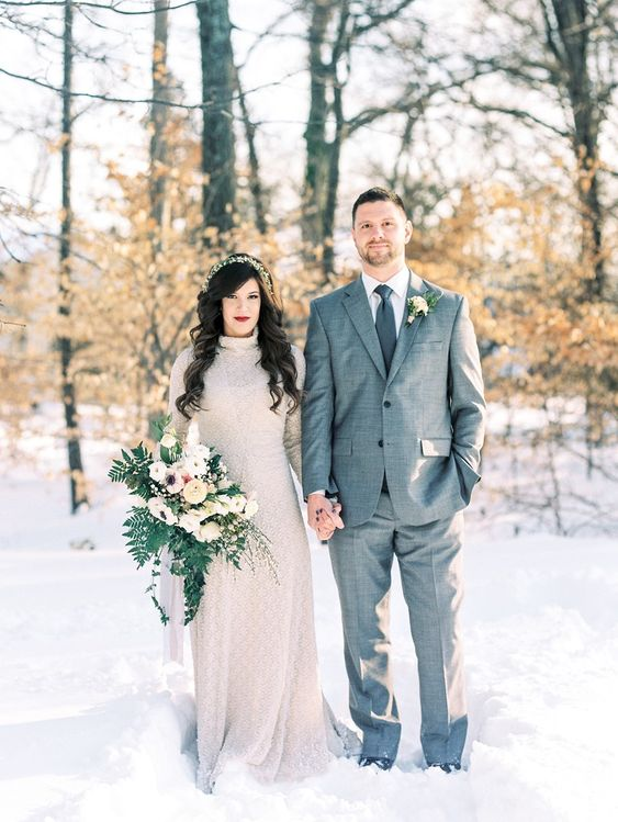 a couple portrait in a snowy forest is a great idea to embrace the season and enjoy the weather