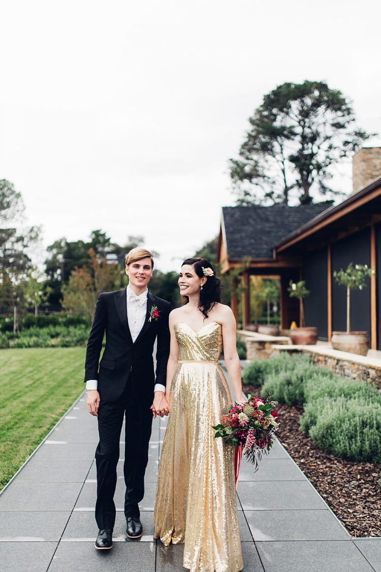 a glam gold sequin strapless wedding dress with a highlighted waist is a chic and gorgeous idea for a holiday wedding