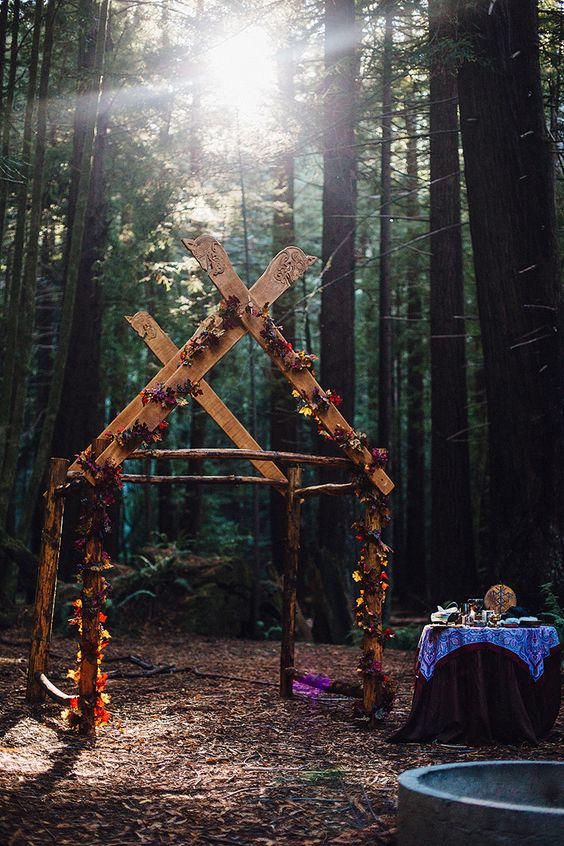 a gorgeous Nordic wedding altar in the forest decorated with bold blooms follows the ancient traditions of Scandinavian countries
