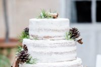 12 a naked wedding cake with piecones, cinnamon bark and greeneery to follow the trend of naked cakes