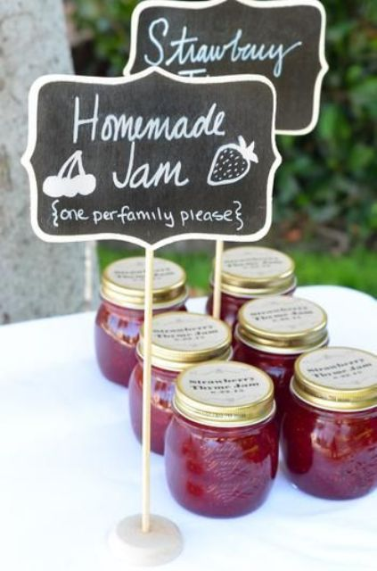 homemade strawberry jam in indivisual jars is timeless, make some jam yourself and serve it for your guests