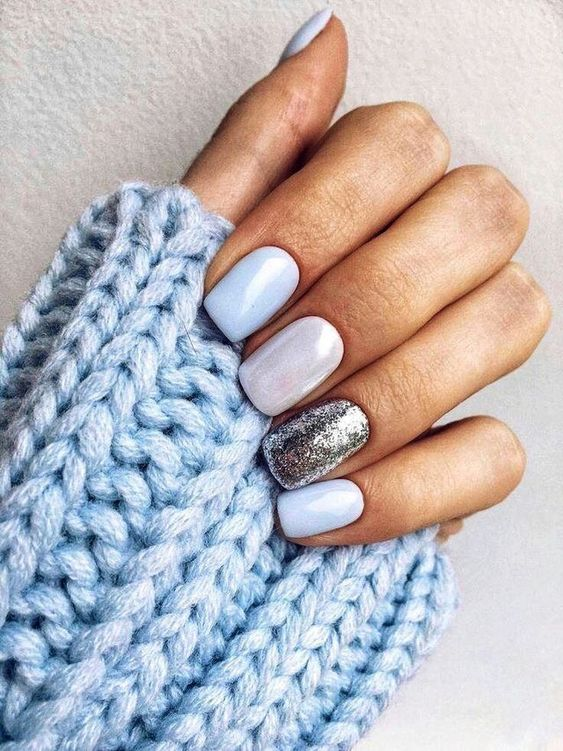 white, powder blue and silver glitter manicure for a frozen feel on your nails