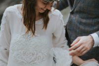 13 a boho bridal look with a layered tulle skirt and a top with long sleeves, lace trim and patterns