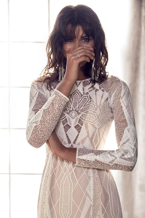 a fitting geometric wedding dress with long sleeves and a high neckline for a modern boho bride