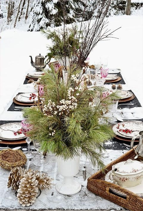 evergreens and berries, branches in vintage urns amd pinecones for a cozy winter Scandinavian wedding