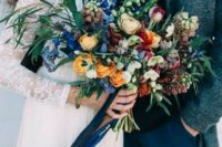 14 a colorful wedding bouquet with blue, orange, red and burgundy blooms and grasses of different kinds