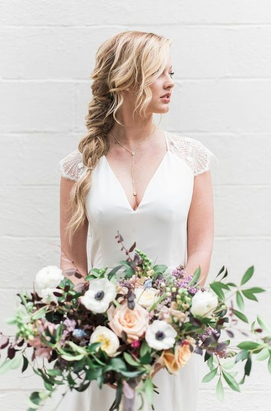 a delicate twisted braid with some bangs looks very chic and subtle, it's perfect for boho brides and can be accessorized with blooms