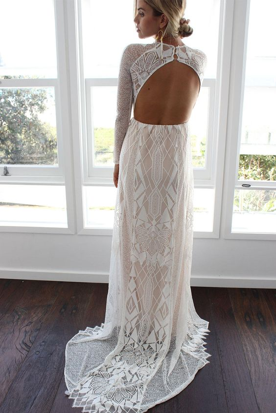 a geometric lace fitting wedding gown with long sleeves, a cutout back and a train for a modern boho bride