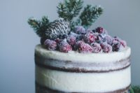 14 a semi naked wedding cake topped with a pinecone, evergreens and sugared berries for Christmas