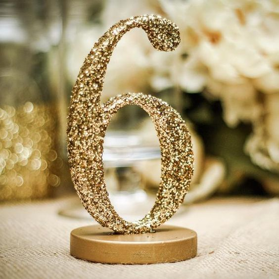 gold glitter table numbers will add some glam to every wedding tablescape, you may DIY them easily