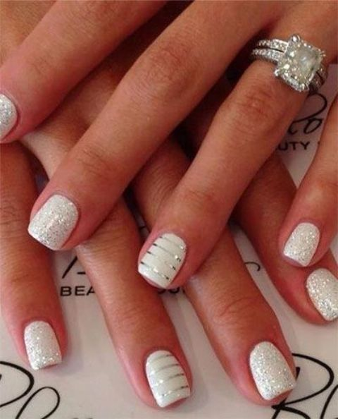 white nails with a touch of glitter on top and white ones with silver stripes to sparkle all over