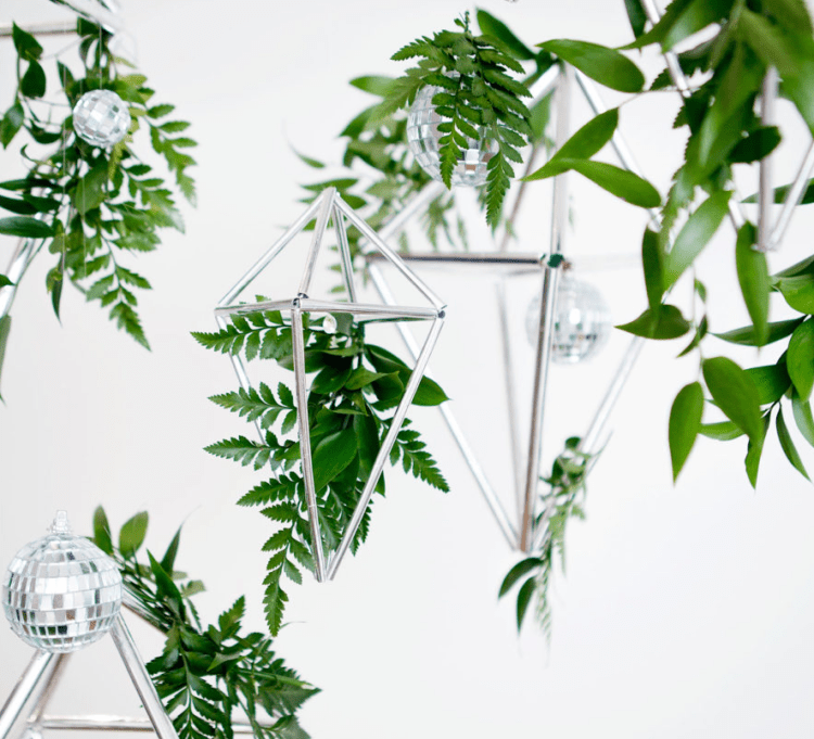 silver diamonds and disco balls with greenery decor to create a modern and fresh backdrop or decor