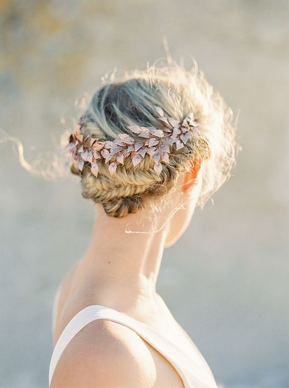 a fishtail braided updo accessorized with a rose gold hairpiece for a summer or spring Nordic wedding