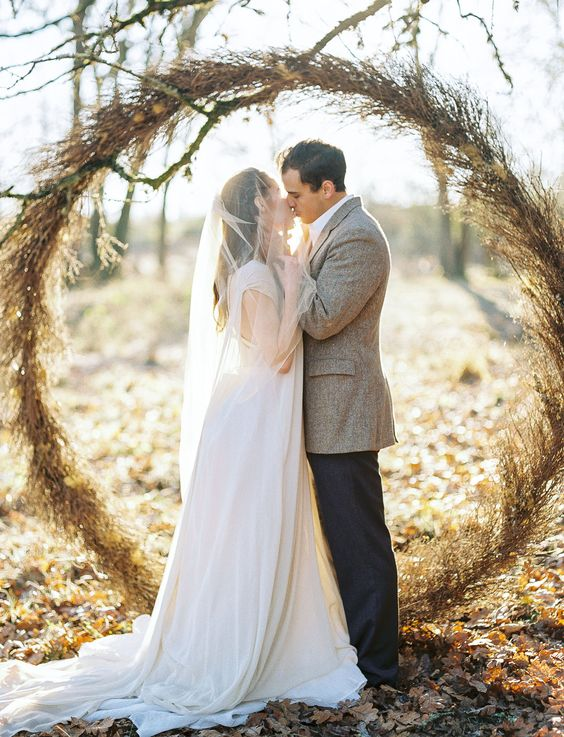 an organic dried herb and foliage giant wreath arch is a hot trend, and will be great for a fall wedding