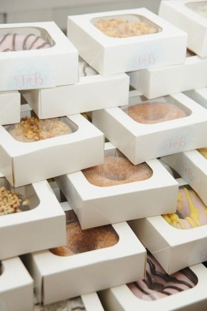 glazed donuts in individual boxes are a cool idea of a tasty edible wedding favor