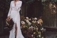 17 a boho lace wrap wedding dress with sleeves, a deep V-neckline, a slit and a ruffled skirt with a train, black boots