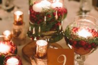 17 a cozy traditional Christmas wedding centerpiece of pinecones, mercury glass candle holders and jars with evergreens, cranberries and candles