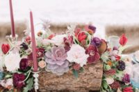 17 a luxurious boho chic wedding centerpiece in the shades of burgundy, plum, pink, red plus colorful succulents
