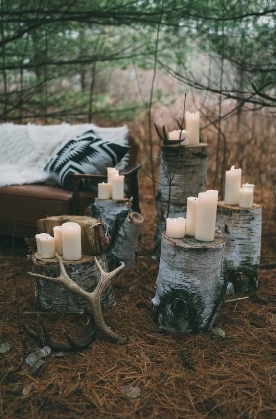 birch stumps holding antlers and candles will give a Scandinavian feel to your wedding lounge or ceremony space