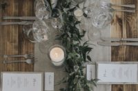 18 a grey table runner and napkins plus white candles and fresh greenery for a simple rustic look